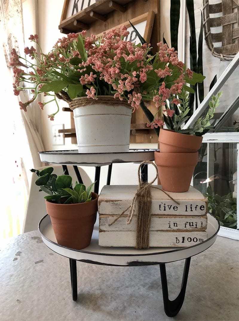 These Farmhouse Dollar Store Hacks With A High End Look will add the perfect touch of charm and style to your home. The best part is… it will not break the budget!