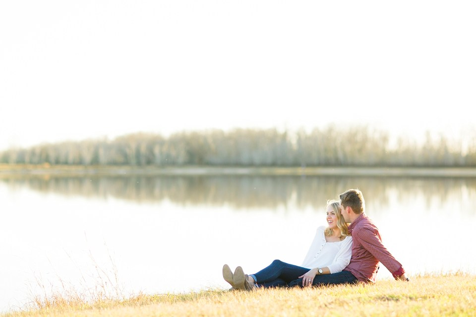 young couple relaxing by water