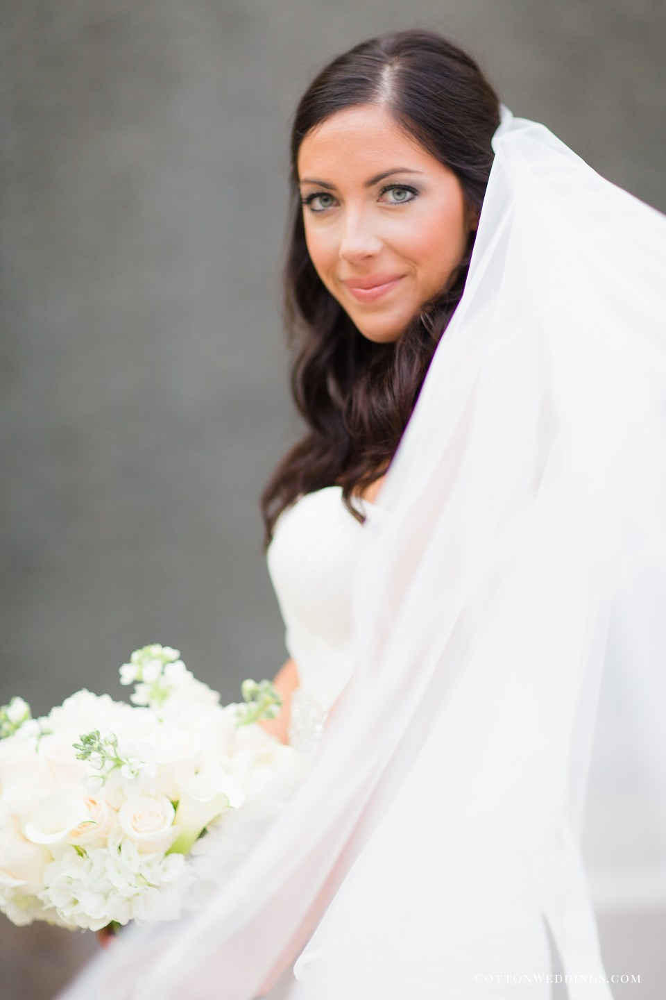 beautiful bride veil blowing in the wind