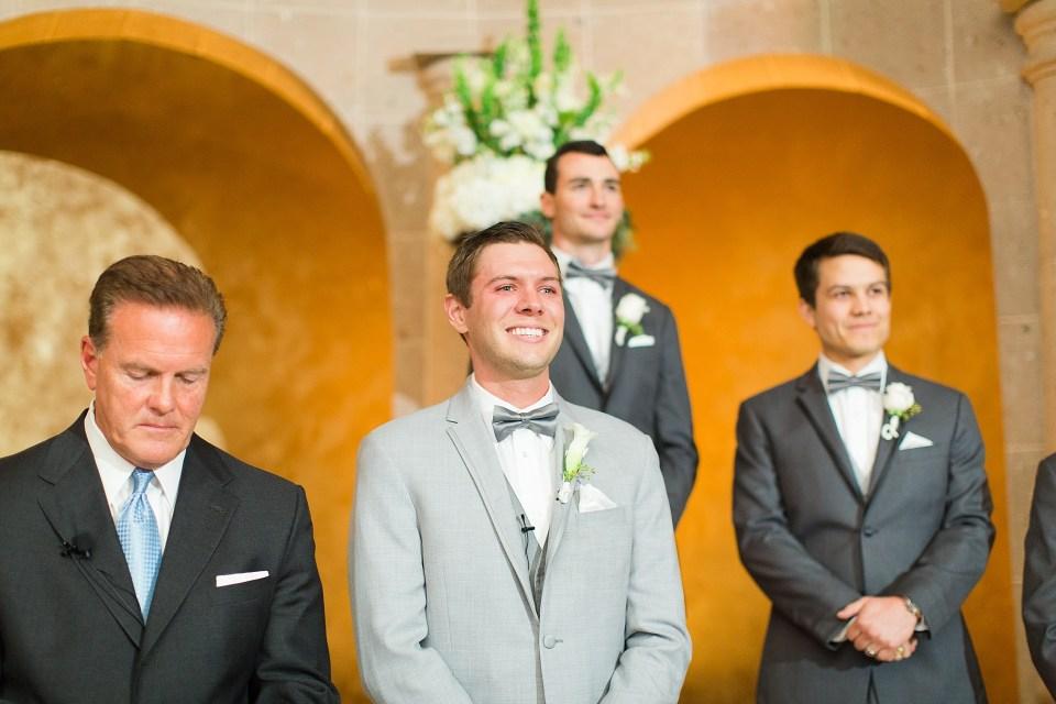 groom beaming at bride