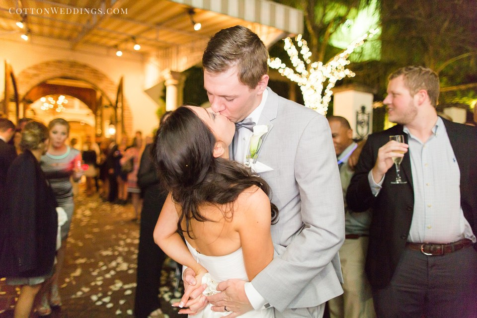 bride and groom kiss during exit