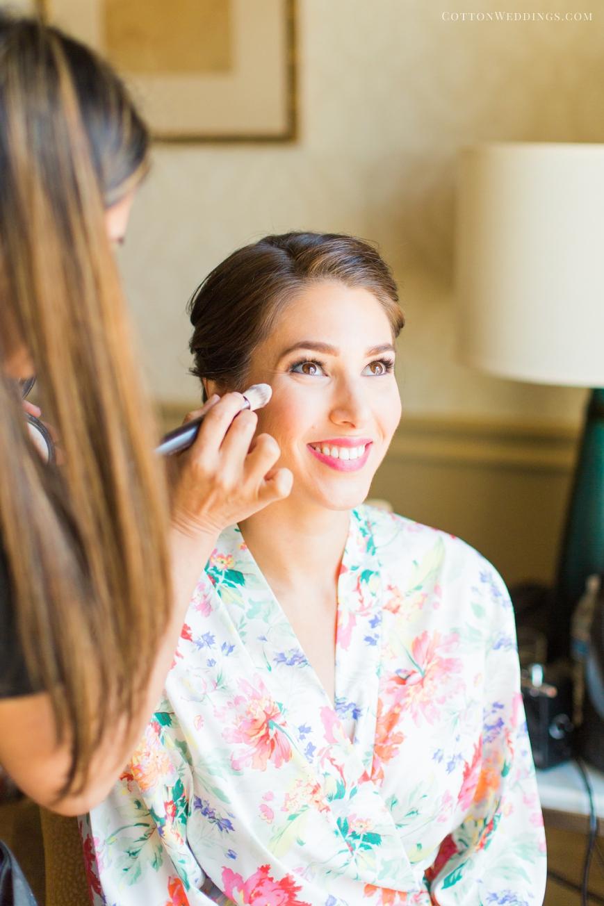 bride smiling getting makeup done