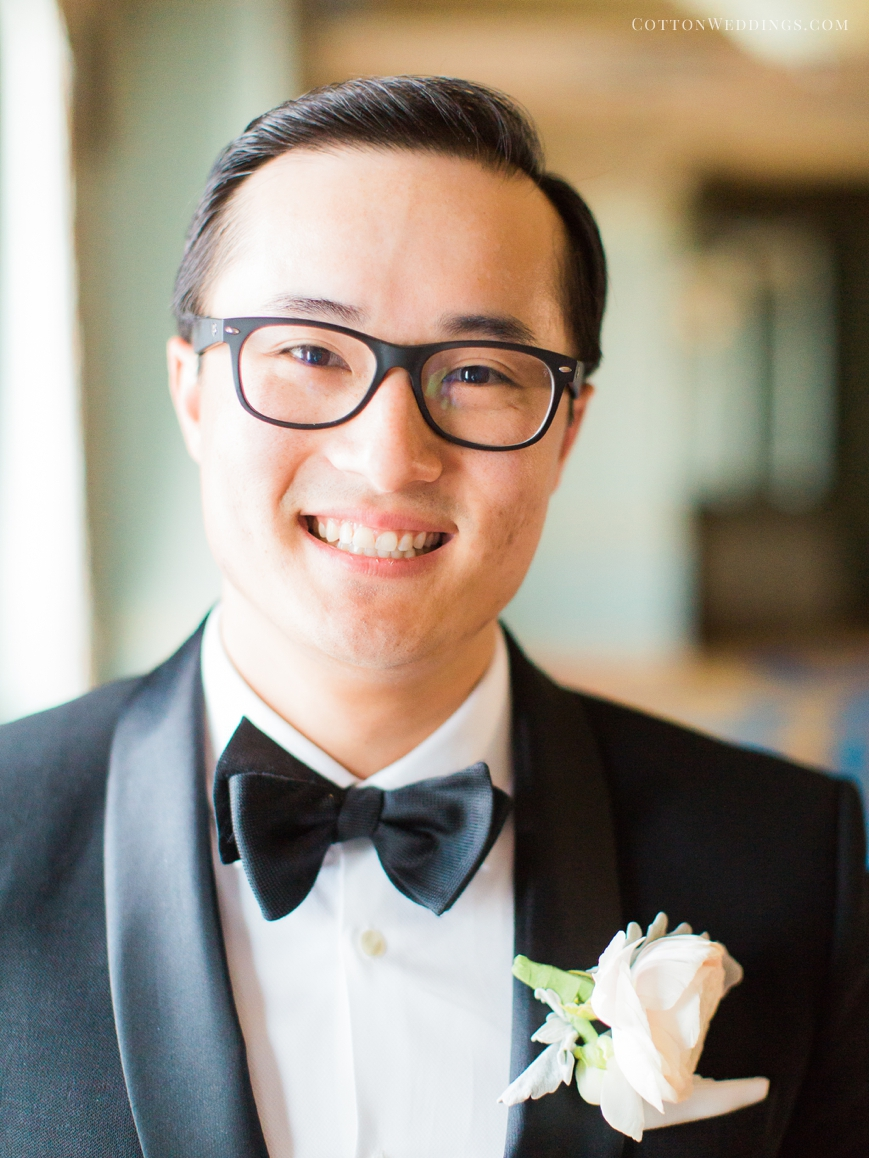 adorable asian groom with bowtie