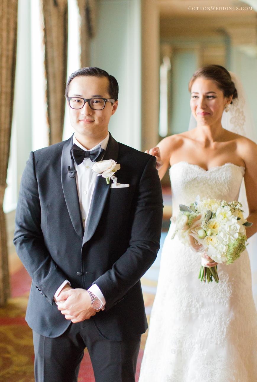 bride tapping groom on shoulder