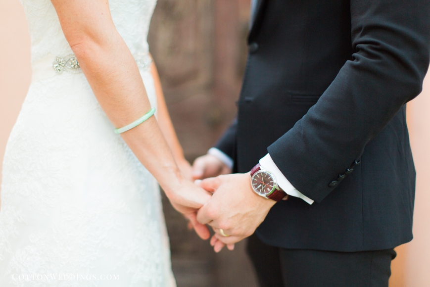 bride and groom holding hands with gifts