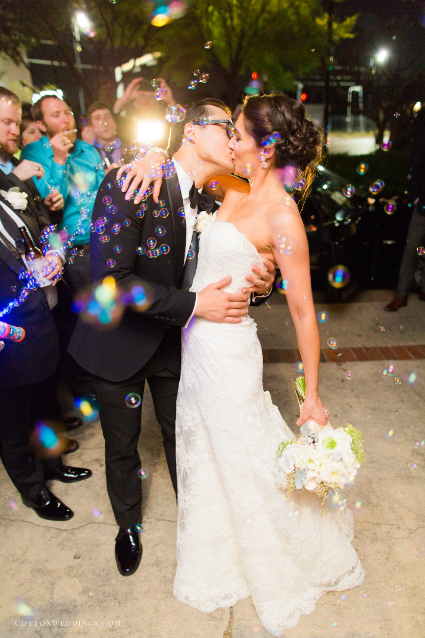 bride and groom kissing bubble exit