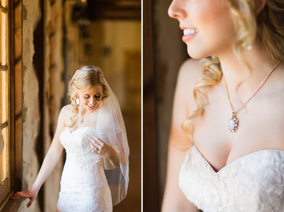 bride standing at window bride wearing grandmother's opal necklace