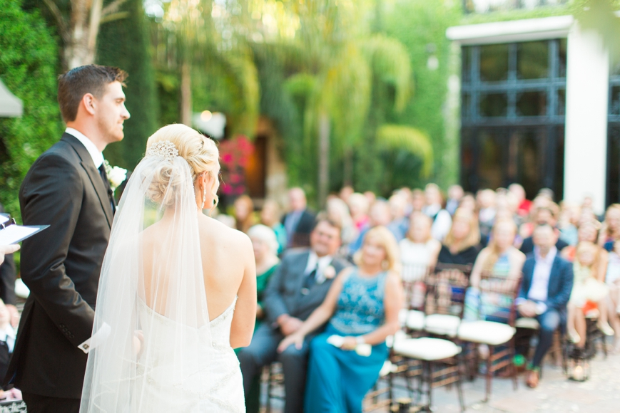 bride and groom face their friends and family