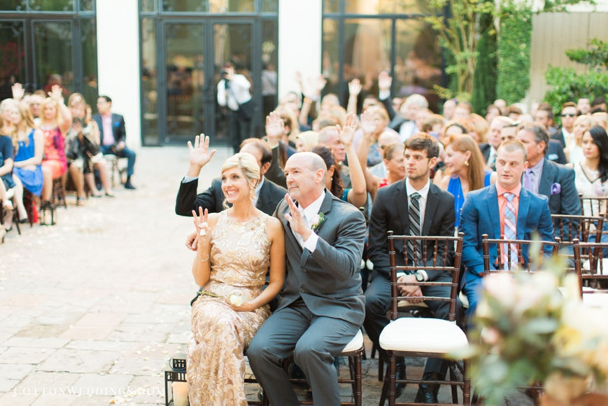 friends and family raise hands in love during ceremony