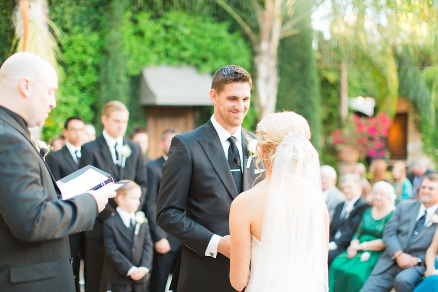 happy groom smiling at bride