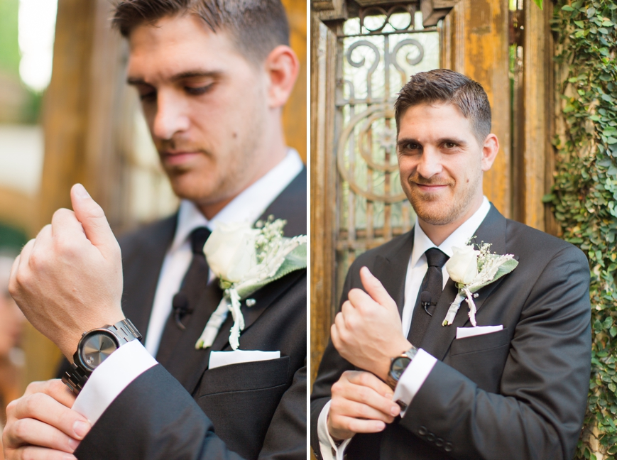 groom putting on watch gift from bride