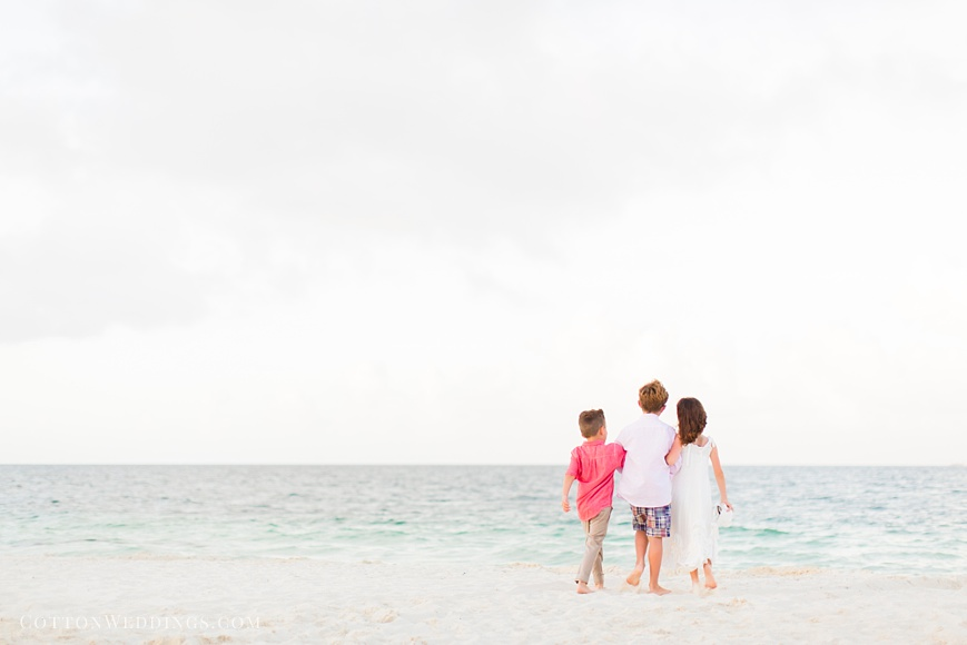 adorable photo of little girl and boys walking on the beach