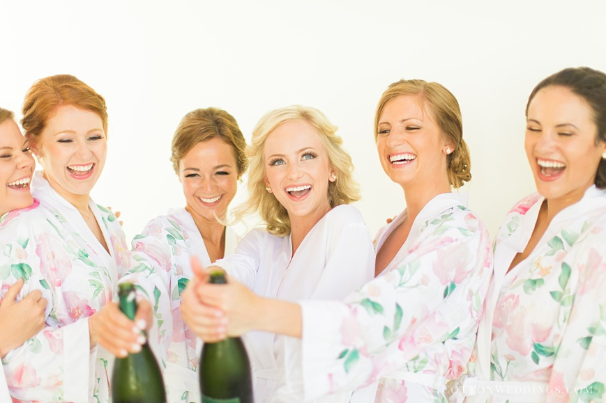 bride pop champagne bottle with bridesmaids