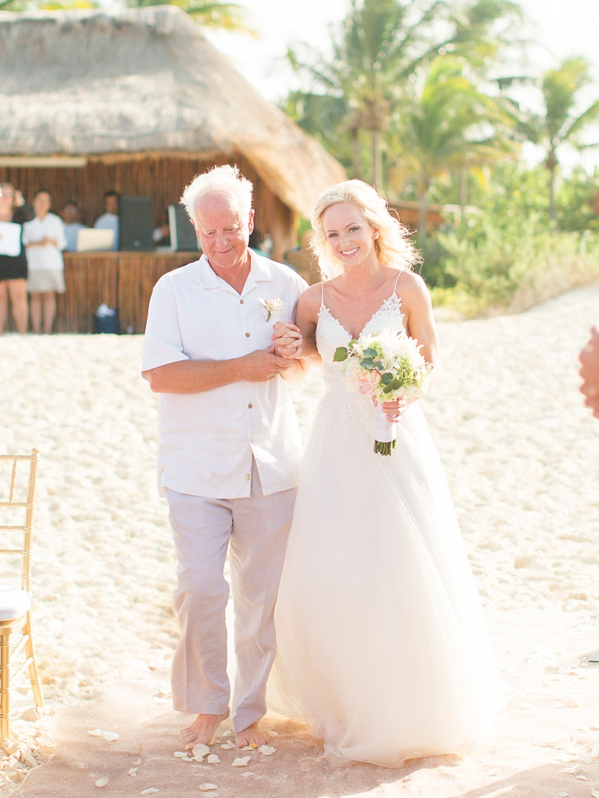 bride and father walking down the aisle at beach wedding