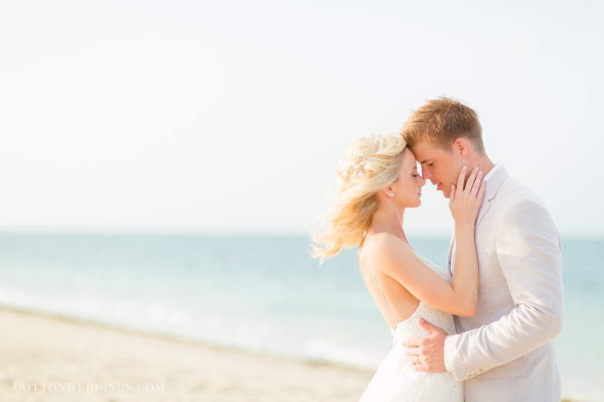 airy sunny light portrait of bride and groom on beach