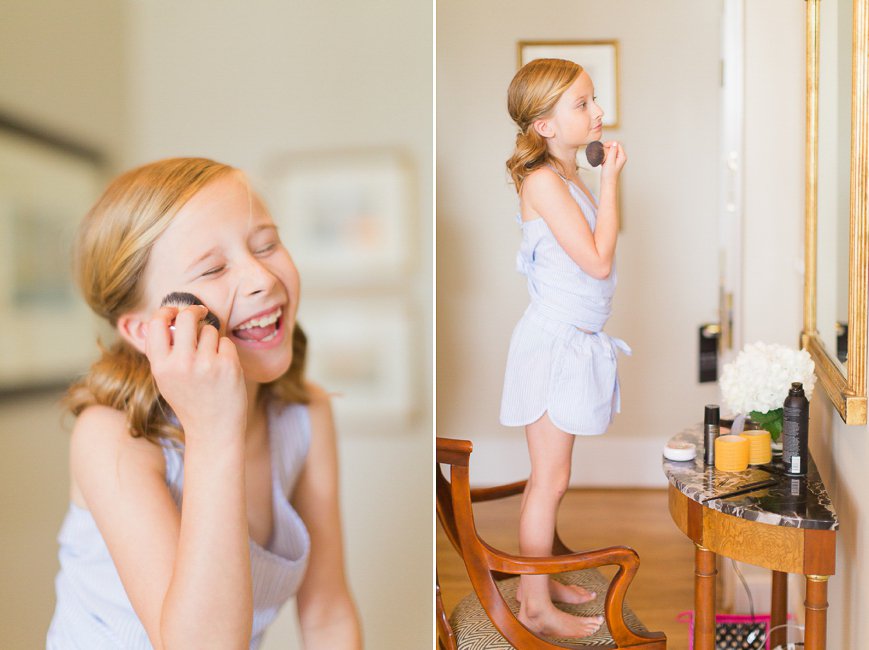 adorable flower girl putting on makeup