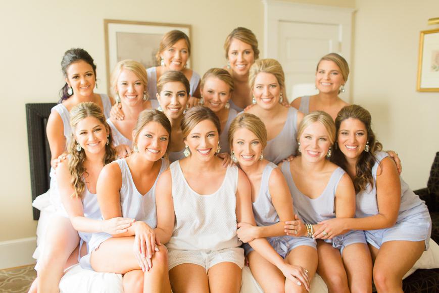 bride and bridesmaids sitting on bed j crew sleep set