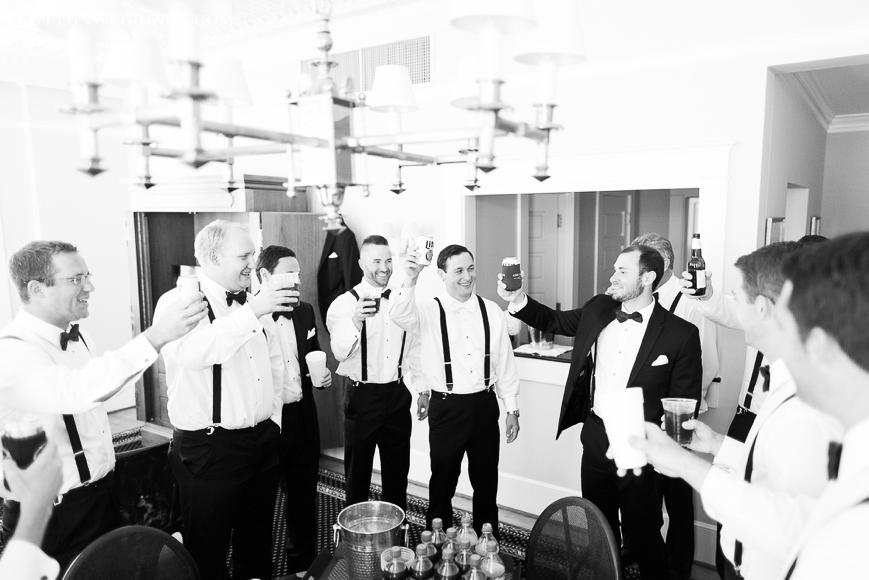 groom toasting with groomsmen