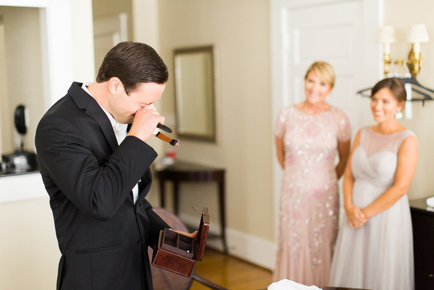 groom crying opening gift from bride