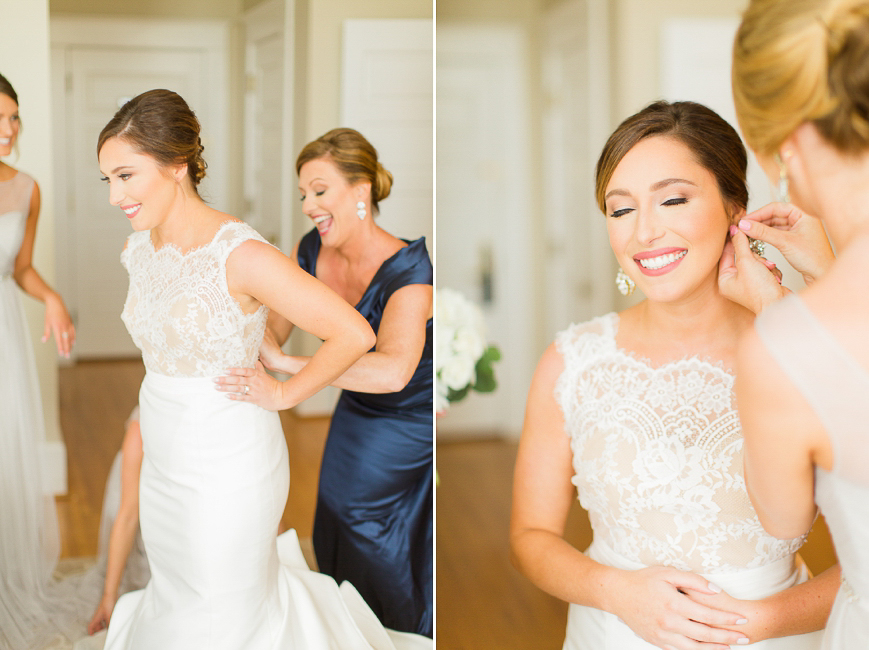 mother helping bride put on dress