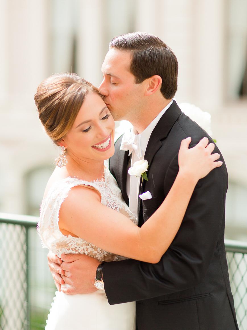 sweet groom kissing bride on cheek