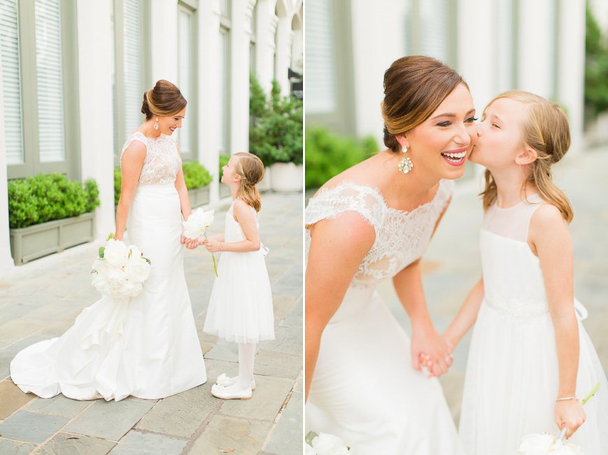bride with adorable flower girl kissing on the cheek