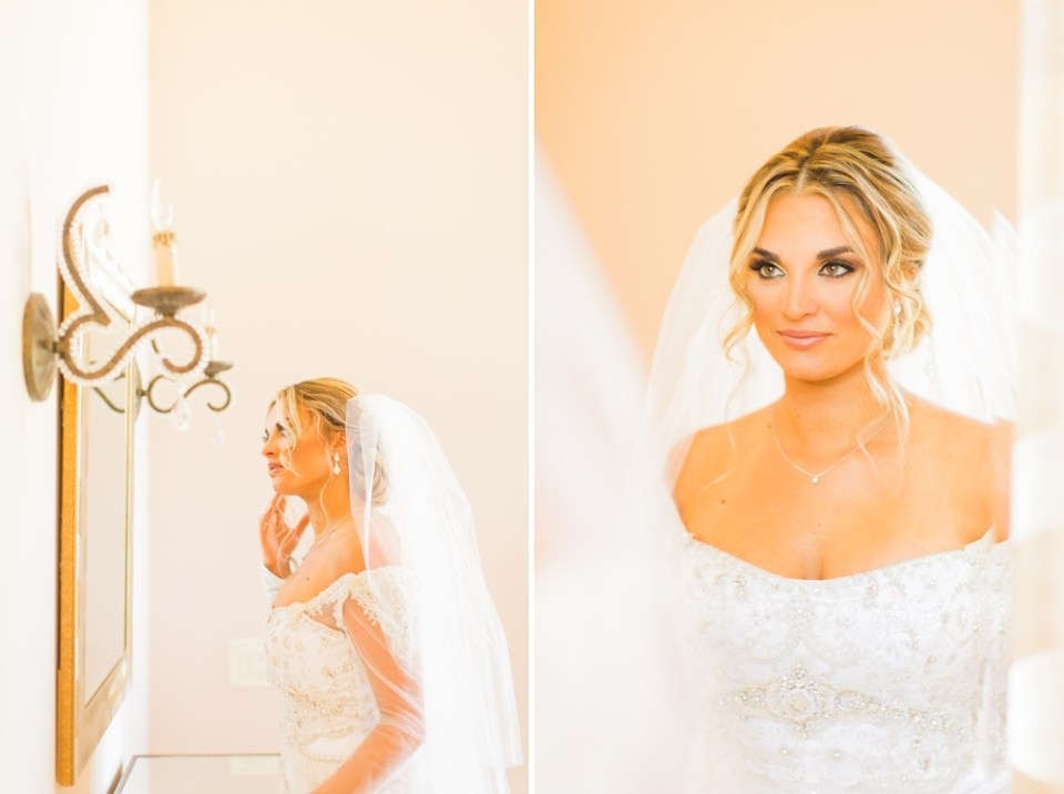 stunning photo of bride looking in mirror