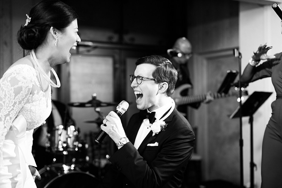 groom singing to bride at wedding