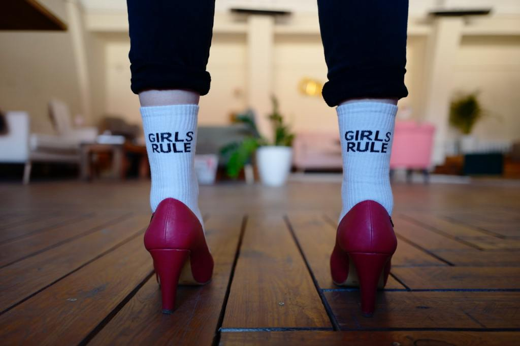 a white girl wearing a pair of white socks with girls rule text