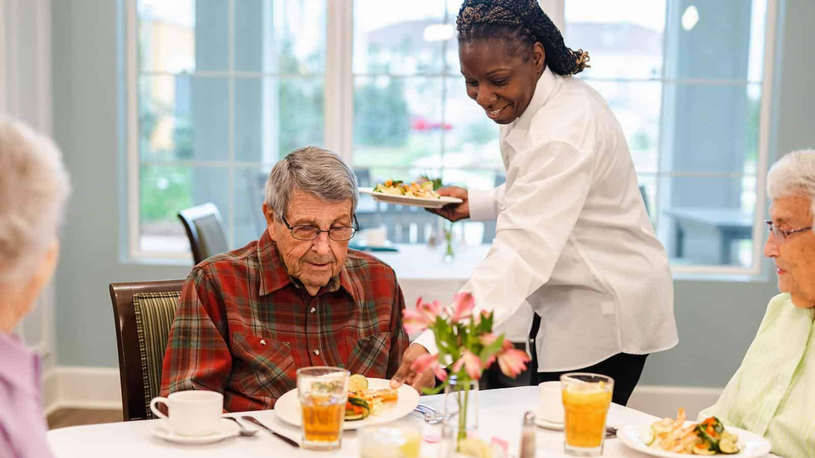 Seniors Dining Table Waitress Serving Food