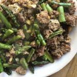 Pork and asparagus stir fry plated close up