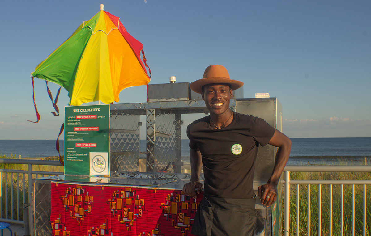 Babajide at Beach 74th street with the food cart, summer 2019.