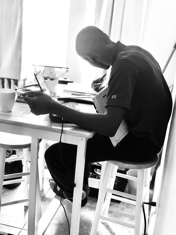Babajide Aloa studying.