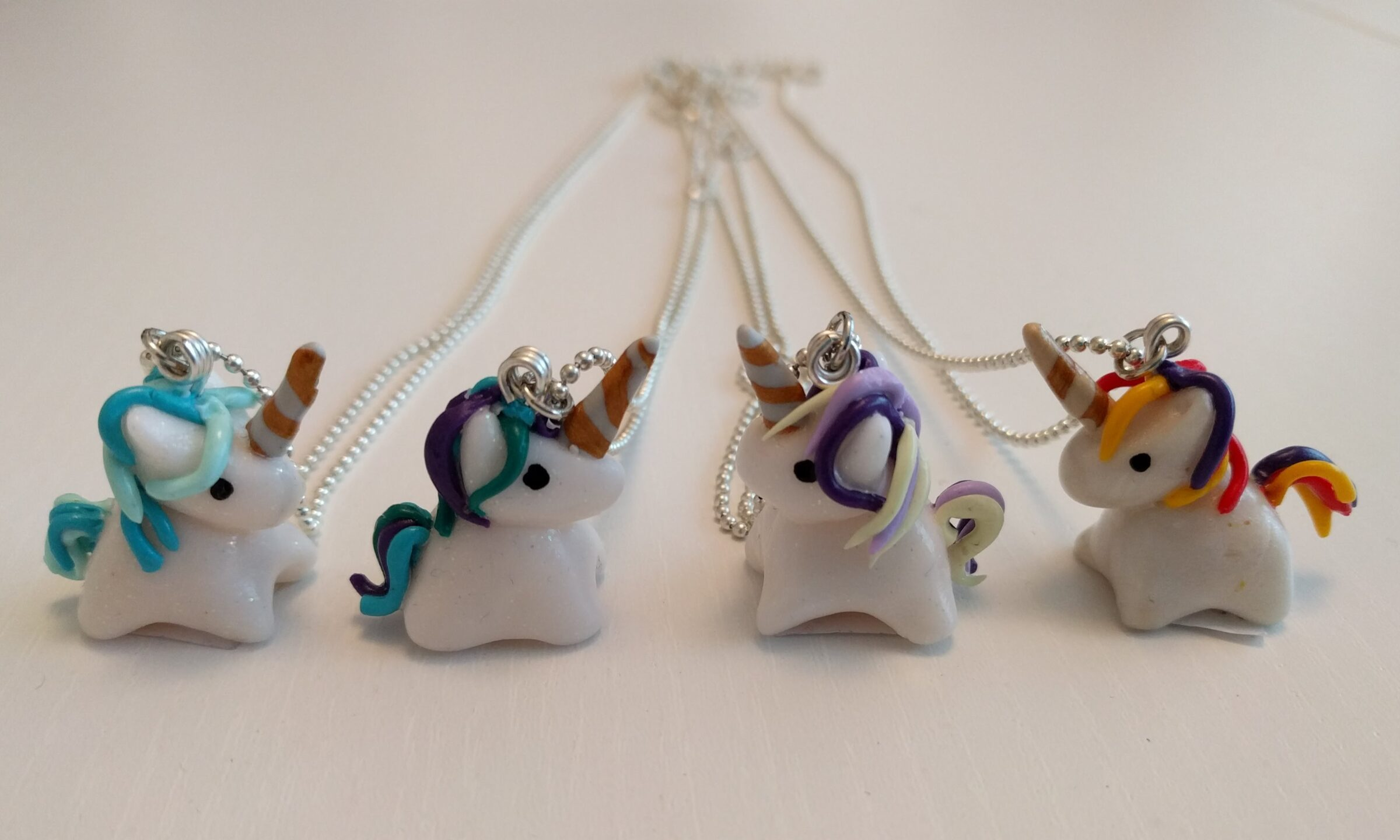 Four fimo unicorn necklaces
