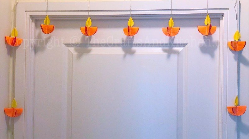 Paper diyas on doorway