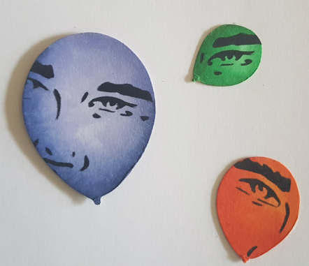 Stamped face onto balloons