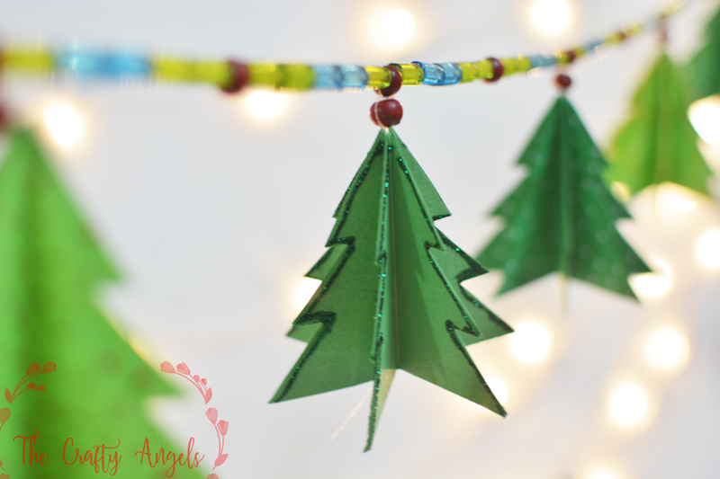 diy paper christmas tree garland, christmas tree decor, christmas tree ornament, diy tree ornament, diy paper christmas tree ornament, holiday crafting, holiday activity, holiday decor, holiday idea