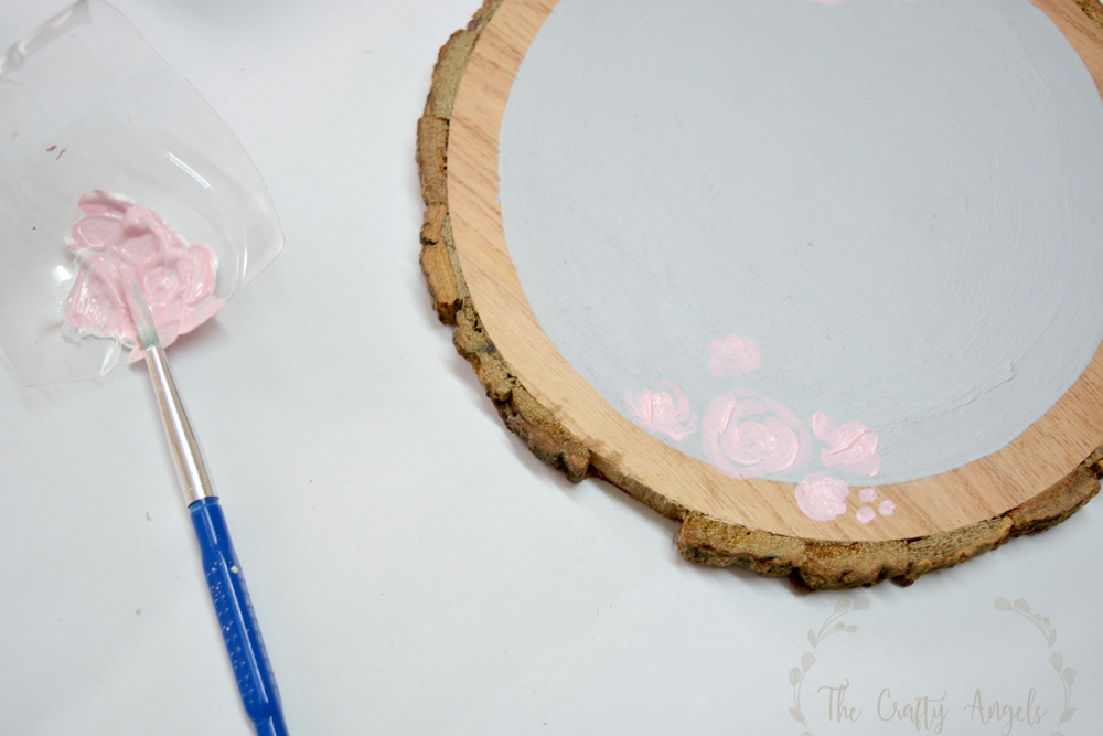 painting roses on wood slice