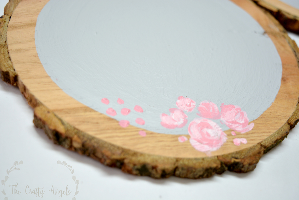 painting rose flowers on wood slice