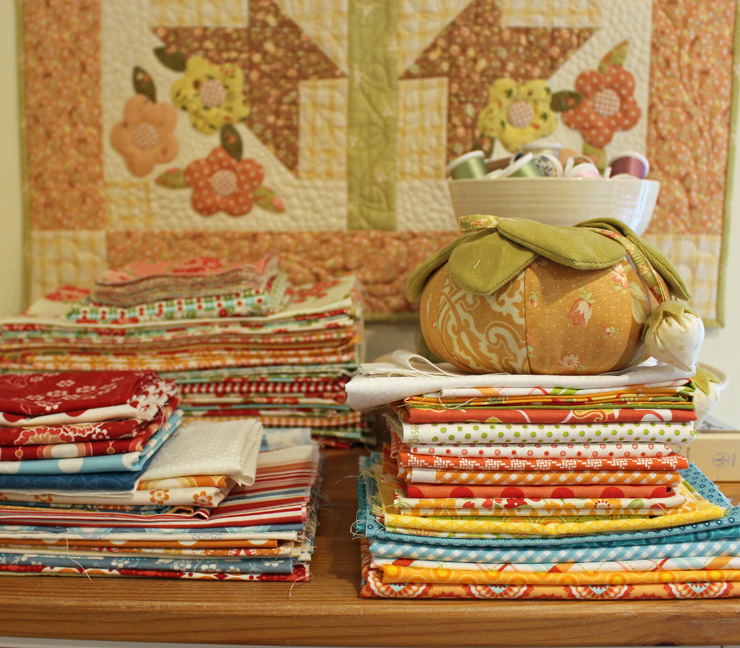 Fabric neatly stacked @ The Crafty Quilter