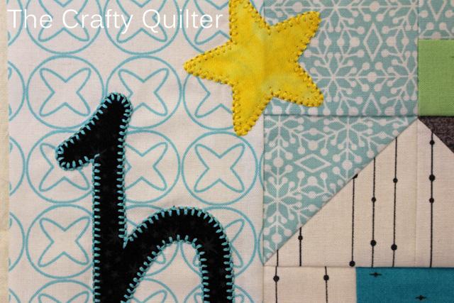 Blanket stitch detail @ The Crafty Quilter