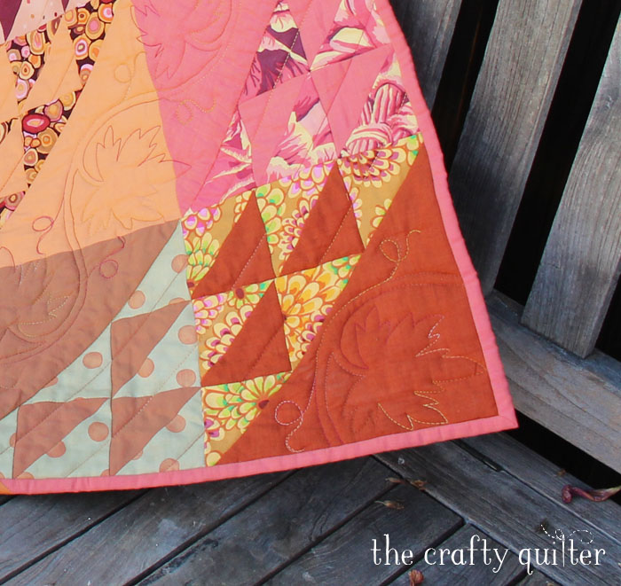 How to join binding ends with the pocket method and how to make a perfectly mitered corner at The Crafty Quilter.