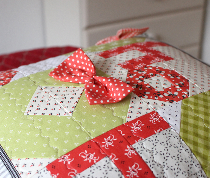 """Ho Ho Farmhouse Pillow Tutorial at The Crafty Quilter. 18"""" square pillow is a perfect addition to your holiday decor."""