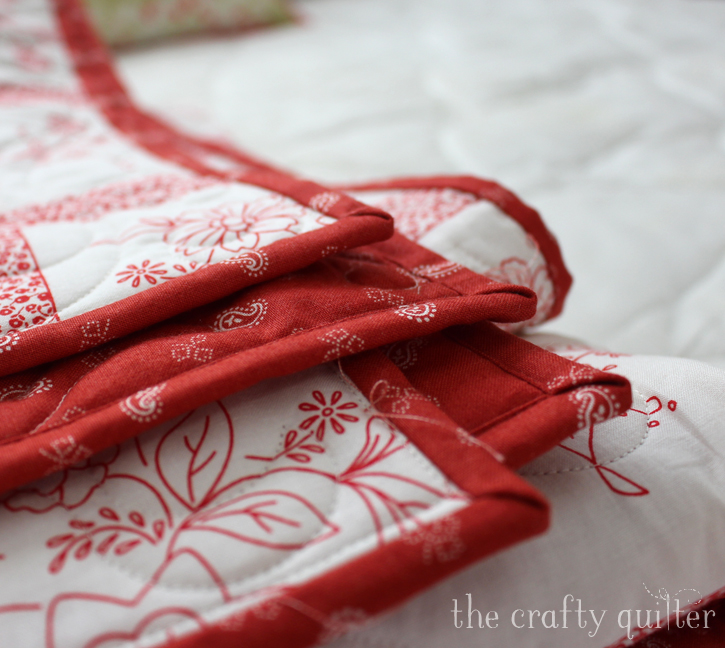 WIP Wednesday, stuck in the binding phase of five quilts!  Julie @ The Crafty Quilter