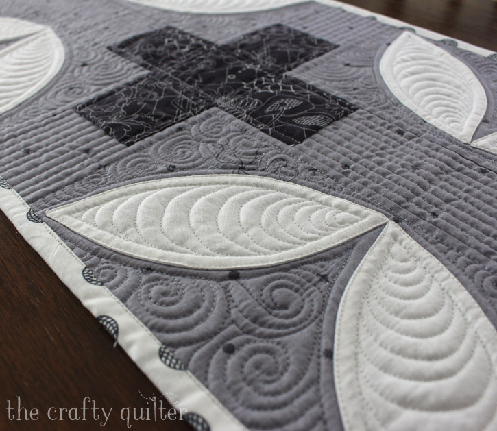 Modern Plus Signs Quilt Book Hop, table runner made by Julie Cefalu. Pattern is Petals Plus by Cheryl Brickey and Paige Alexander from their book, Modern Plus Signs