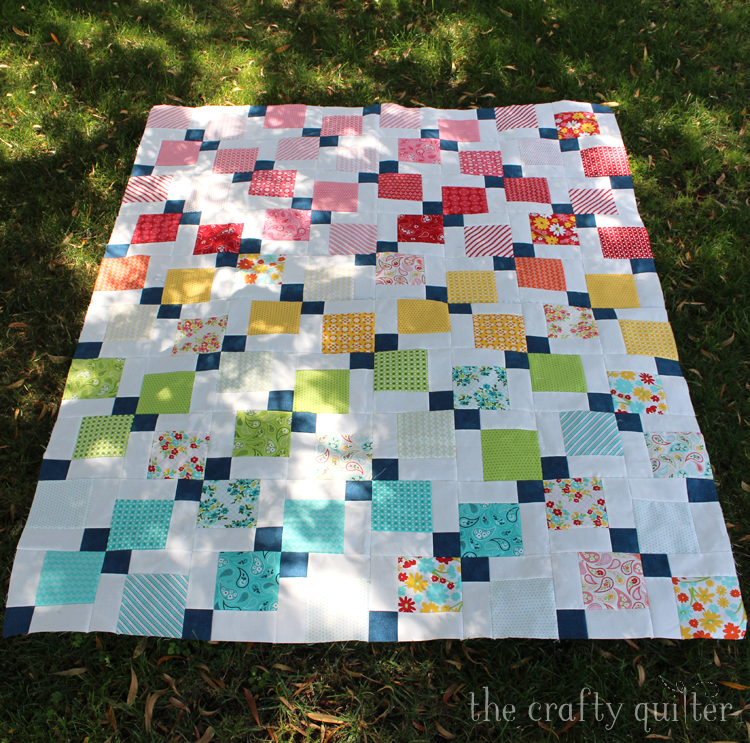 Disappearing 9-patch quilt made by Julie Cefalu @ The Crafty Quilter.
