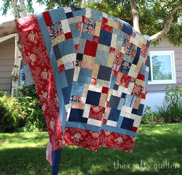 Patriotic picnic quilt made by Julie Cefalu @ The Crafty Quilter for the Disappearing 9-patch quilt along.