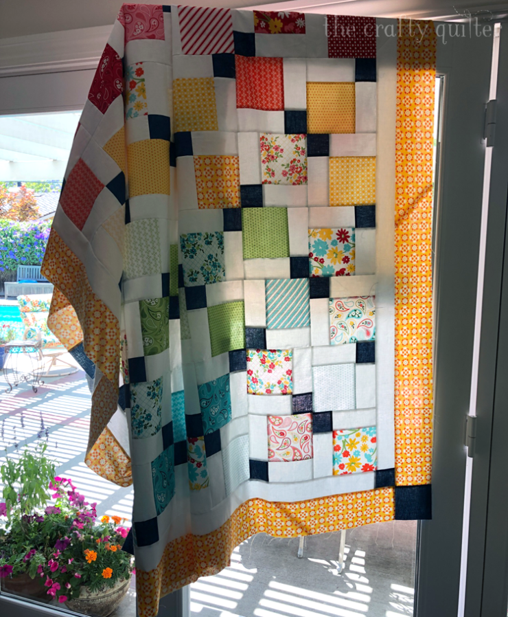 Disappearing 9-patch quilt made by Julie Cefalu @ The Crafty Quilter