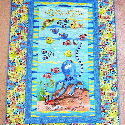 June winner of the UFO & WIP Challenge at The Crafty Quilter is Mari K. who made this Under The Sea quilt for her grandson.