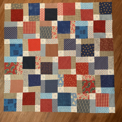 Scrappy lap quilt for a veteran, made by entry #39 to the Disappearing 9-patch Quilt Along @ The Crafty Quilter